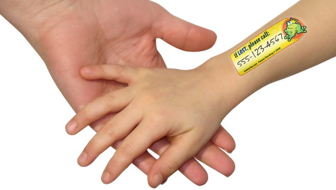 An idea for recovering a lost child: a stick-on tattoo with a cellphone number to call.