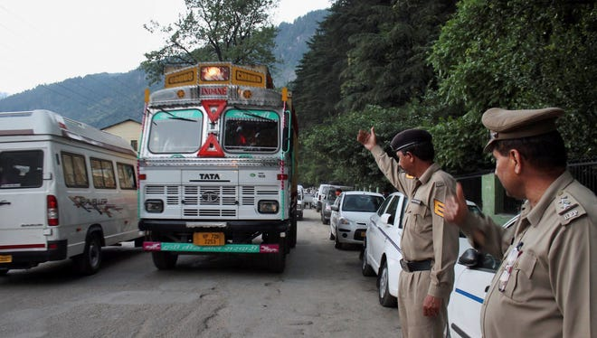 India police keep a check on vehicles after a U.S. woman was gang-raped Tuesday in a resort town. On Wednesday, their was an arrest in another rape of an Irish woman.