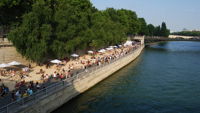 The Paris Plages brings a sandy beach to the banks of the Seine for a month each summer.