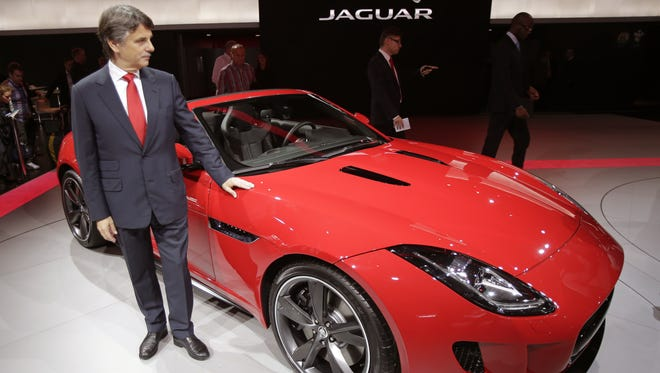 Ralf Speth, chief executive officer of Jaguar LandRover, poses next to a new Jaguar F-Type during the press day at the Paris auto show.