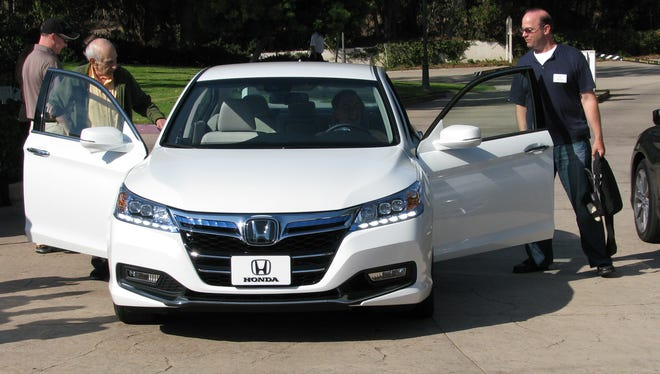 Honda is staking a lot on products such as the new Accord, shown here in its plug-in version.