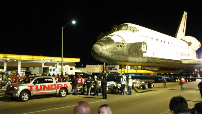 A Toyota Tundra pickup prepares to tow the retired space shuttle Endeavour in Inglewood, Calif.