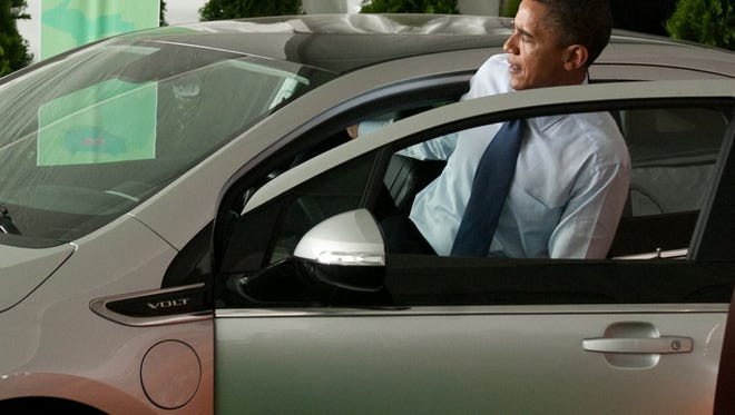 President Barack Obama gets out of an electric Chevy Volt following a groundbreaking ceremony for Compact Power's new advanced battery factory in Holland, Mich.