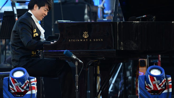 Chinese pianist Lang Lang performs during the Queen's Diamond Jubilee Concert at Buckingham Palace in London.