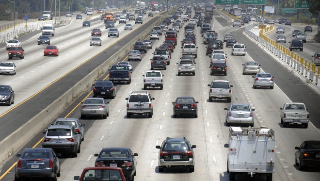 In this July 3, 2008, photo, traffic stacks up on the eastbound Santa Monica Freeway in Los Angeles. New cars may be required to have black boxes.