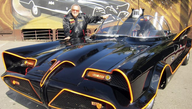 Auto customizer George Barris poses with the original Batmobile, auctioned on Jan. 19 at the Barrett-Jackson auction house in Scottsdale, Ariz.