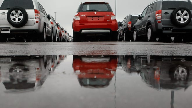Unsold Suzuki automobiles sit parked in the Dundalk Marine Terminal at the port of Baltimore two years ago