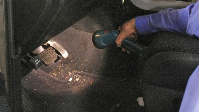 Earl Stewart, owner of Earl Stewart Toyota, shows the faulty accelerator pedal  on one of the recalled Toyota vehicles in North Palm Beach, Fla., in 2010