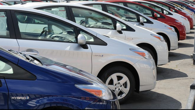 Toyota Prius hybrid model cars wait for customers at a Toyota dealer in Hollywood in this 2010 file photo