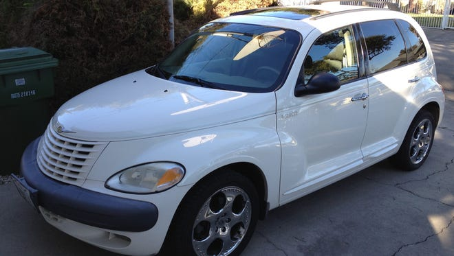 The author bought this 2001 PT Cruiser for $4,500 recently. He loves it.