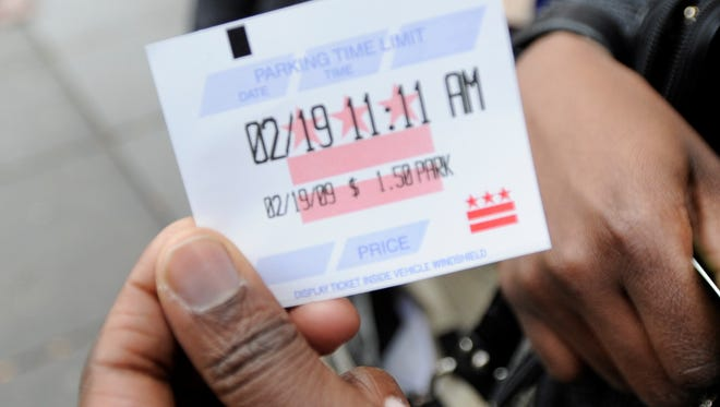Mouna Konate, 30, shows a receipt printed by the smart meter in Washington, D.C., in Februrary 2009.