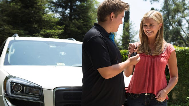 Nancy O'Dell hands over the car keys to son Tyler, 17,