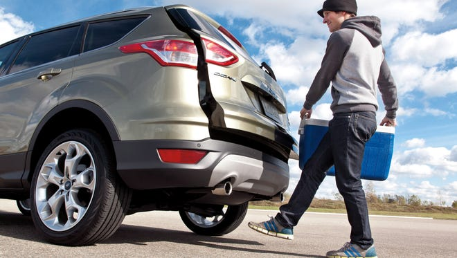 The kick-to-open tailgate on the 2013 Ford Escape is most popular in Dallas