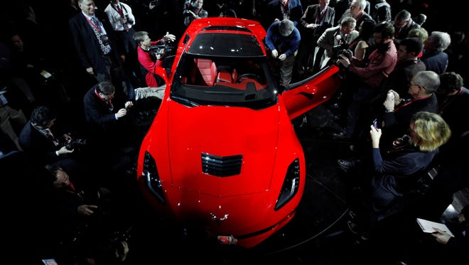 Journalists surround General Motors' new 2014 Chevrolet Corvette Stingray last January in Detroit.