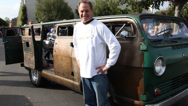 "Casey Moir proudly stands next to his 1964 Chevy van ""rat rod"" in Irvine, Calif."