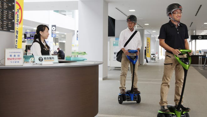 Toyota is going to test an advanced version of its Segway-like personal transporter.