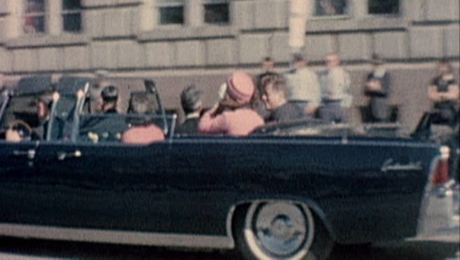 President John F. Kennedy and Jacqueline Kennedy are shown riding in a motorcade moments before the president was fatally shot..