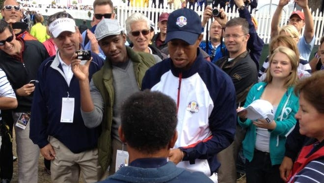 Tiger Woods apologizes to a fan who got hit with an errant tee shot. Woods, practicing for the Ryder Cup, hit a bad tee shot on No.18.