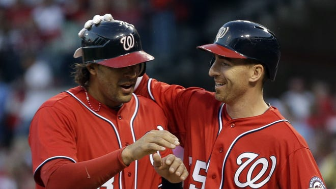 Washington Nationals' Michael Morse, left, is congratulated by teammate Adam LaRoche after hitting a grand slam during the first inning of a baseball game against the St. Louis Cardinals.