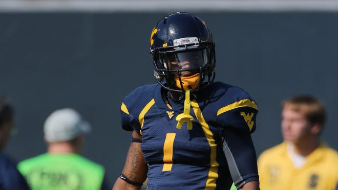 West Virginia Mountaineers wide receiver Tavon Austin (1) warms up prior to the game against the Baylor Bears at Milan Puskar Stadium.
