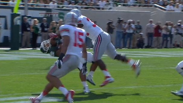 Ohio State's Carlos Hyde hits Nick Hill on a punt return Saturday.