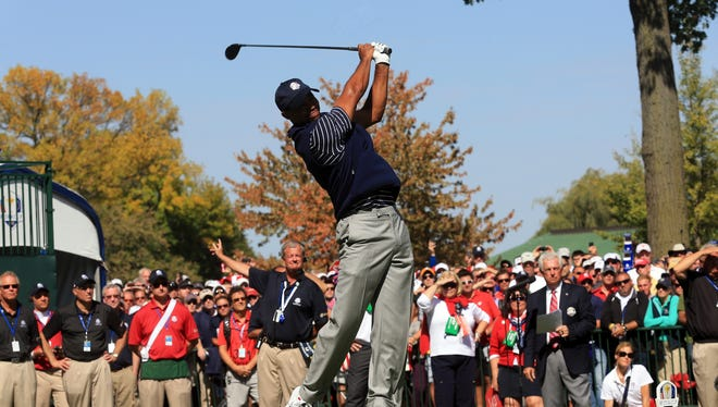 Tiger Woods tees off at No. 1 in the Saturday afternoon fourball session.