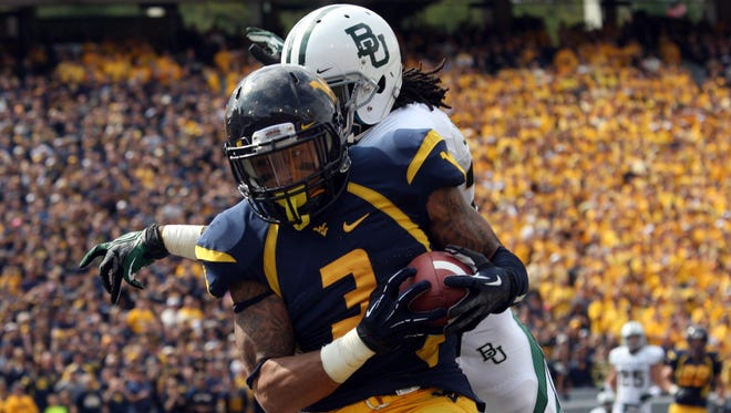 West Virginia wide receiver Stedman Bailey scores one of the game's 10 first-half touchdowns.