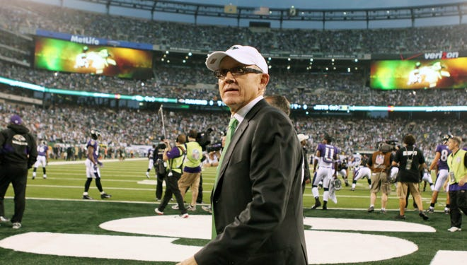 Jets owner Woody Johnson walks on the field before the game against the Ravens at the New Meadowlands Stadium.