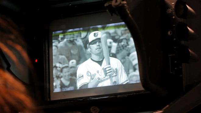 Orioles' Mark Reynolds is seen on a television camera viewfinder during ?a game against the  Angels in June.