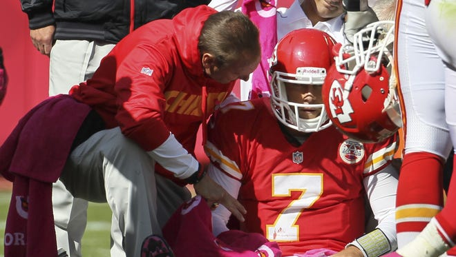 Trainers assist Kansas City Chiefs quarterback Matt Cassel (7) during the second half of an NFL football game against the Baltimore Ravens at Arrowhead Stadium in Kansas City, Mo., Sunday, Oct. 7, 2012.
