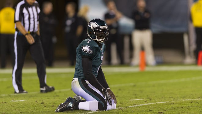 Sep 30, 2012; Philadelphia, PA, USA; Philadelphia Eagles quarterback Michael Vick (7) after being knocked down during the first quarter against the New York Giants at Lincoln Financial Field.