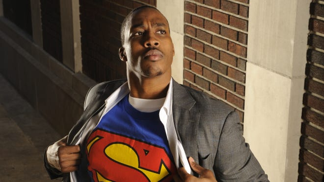 Dwight Howard poses as Clark Kent / Superman in an alley in Downtown Orlando in 2009. Howard, now playing in Los Angeles, is trying to come up with a new nickname.
