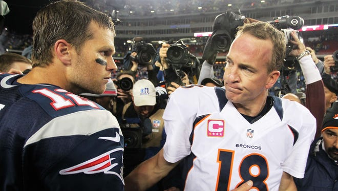 Denver's Peyton Manning, right, facing New England's Tom Brady, left, on CBS' main NFL game Sunday produced the weekend's top TV rating.