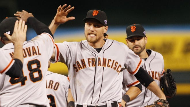 Hunter Pence congratulates his teammates after a 2-1 win in Game 3.