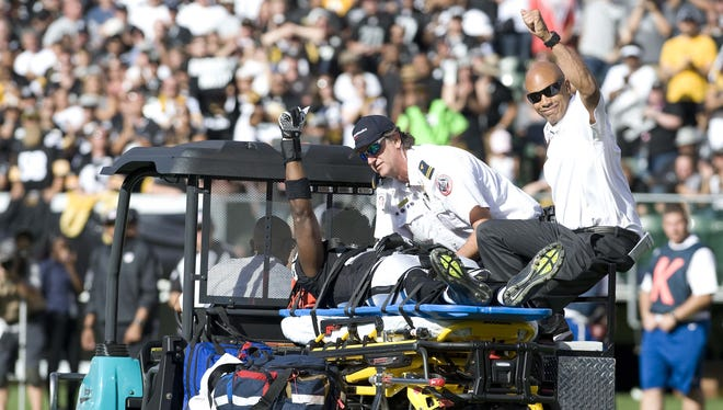 Raiders WR Darrius Heyward-Bey gives the crowd a thumbs up while being carted off the field in Oakland after suffering a Week 3 concussion.