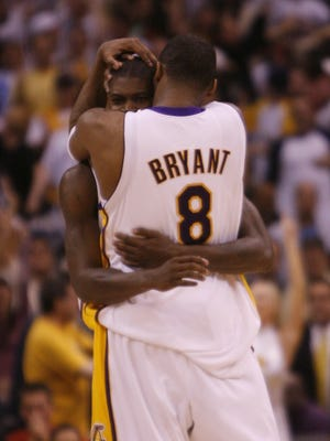 Kobe Bryant and Smush Parker used to be friends. Here, they hug after Game 4 of a 2006 first-round playoff series against the Suns.
