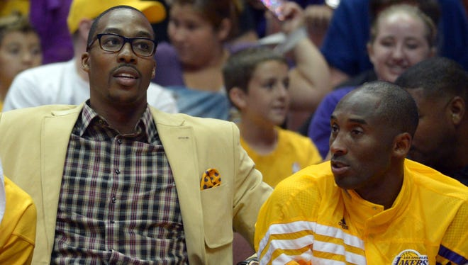 Lakers center Dwight Howard, left, and guard Kobe Bryant are very different people.