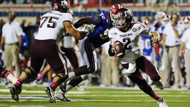 Texas A&M quarterback Johnny Manziel scrambles during the second half of his team's 59-57 win over Louisiana Tech.