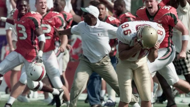 Florida State kicker Matt Munyon reacts after missing a field goal in the final seconds that would have tied the game against Miami on Oct.. 7, 2000.