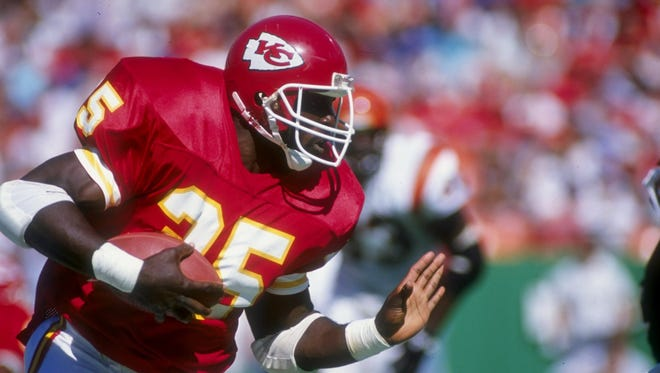 Running back Christian Okoye of the Kansas City Chiefs in action against the Cincinnati Bengals during a 1992 game.