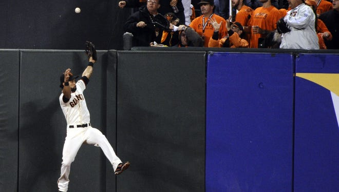 San Francisco Giants outfielder Angel Pagan is unable to catch a ball hit for a two-run home run by Detroit Tigers shortstop Jhonny Peralta in the ninth inning during Game 1.