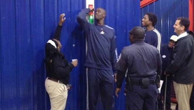Okafor gets measured at Six Flags.