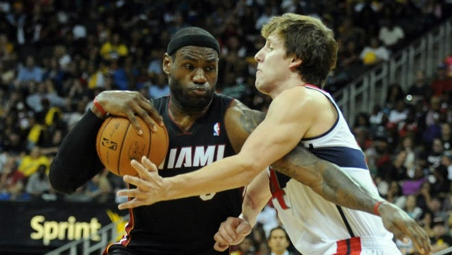 Miami Heat forward LeBron James (6) drives to the basket against Washington Wizards forward Jan Vesely (24) in the third quarter at the Sprint Center.