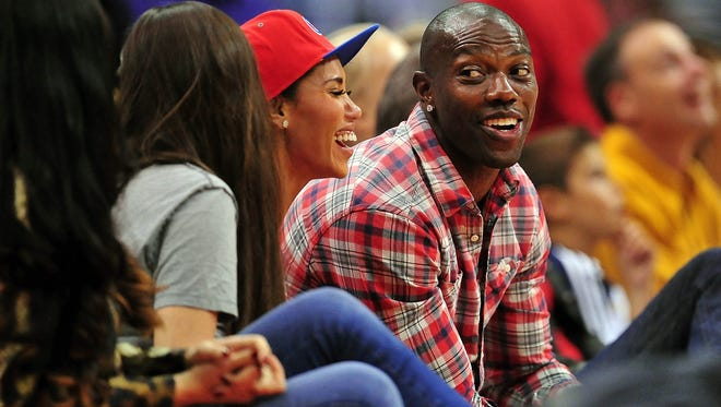 Terrell Owens watches an exhibition between the Los Angeles Lakers and Los Angeles Clippers.