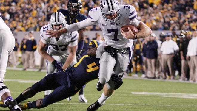 Kansas State quarterback Collin Klein runs through a West Virginia defender to score a touchdown in the second quarter of Saturday's 55-14 win.