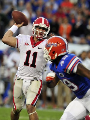 Georgia quarterback Aaron Murray attempts a pass during the Bulldogs' 2011 rivalry game against Florida. The two teams meet again on Saturday.