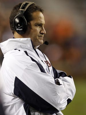 Auburn coach Gene Chizik watches from the sidelines as his team suffers a one-sided loss to Texas A&M.