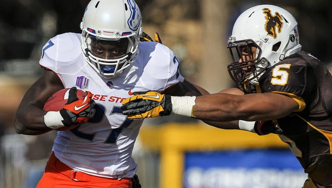 Boise State running back Jay Ajayi breaks away from Wyoming linebacker Korey Jones during the second quarter of a win.