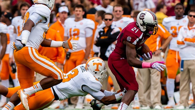 South Carolina running back Marcus Lattimore injured his knee in the second quarter of the Gamecocks' game against Tennessee.
