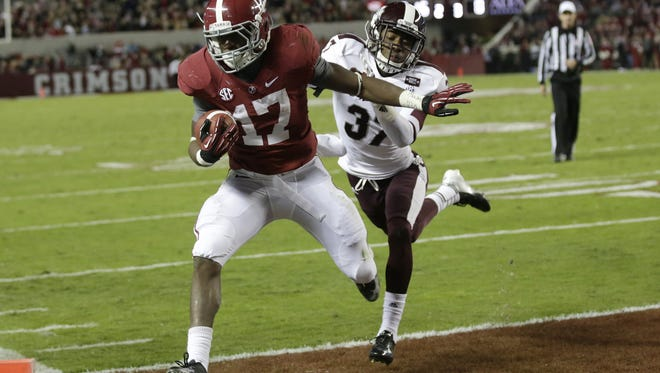 Alabama running back Kenyan Drake scores in the fourth quarter of a win over Mississippi State.